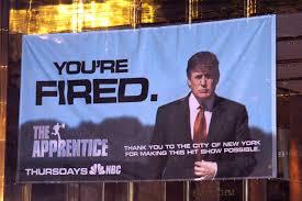 """""""You're fired!"""" da un cartellone pubblicitario dello show """"The Apprentice"""". Fonte: wsj.com - ©Wireimage"""